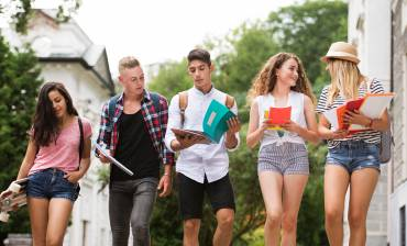 group-of-attractive-teenage-students-walking-to-P5P57FB.jpg